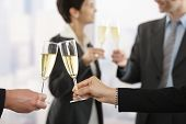 image of toast  - Business people raising toast with champagne at office - JPG