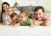 picture of nuclear family  - Happy family having fun posing on floor of in living room at home - JPG