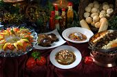stock photo of gourmet food  - image of a beautiful table setting of prepared gourmet foods - JPG