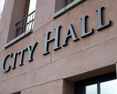 pic of city hall  - Sign on the side of the city hall building - JPG