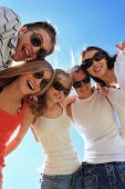 stock photo of young girls  - Cheerful young people having fun on a beach - JPG