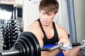 stock photo of muscle man  - Sporty man in the gym centre - JPG