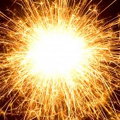 picture of brighten  - Abstract photo of fireworks with free space in the middle - JPG