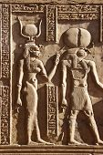 image of isis  - isis and horus stone carvings in egypt - JPG