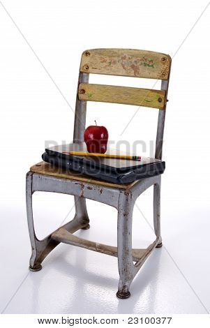 Old Fashioned School Chair With Laptop