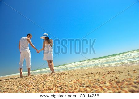 Portrait of young man and woman enjoying a summer vacation.