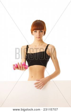 Young woman ggiving fitness weights with blank banner. Isolated