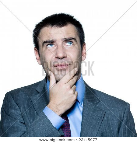 Closeup portrait of confused pensive man looking up in studio on isolated white background