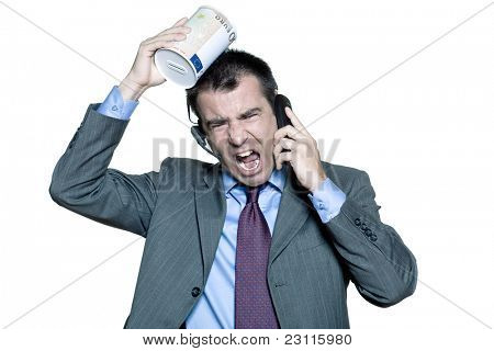 Portrait of angry businessman shouting on phone in studio on isolated white background