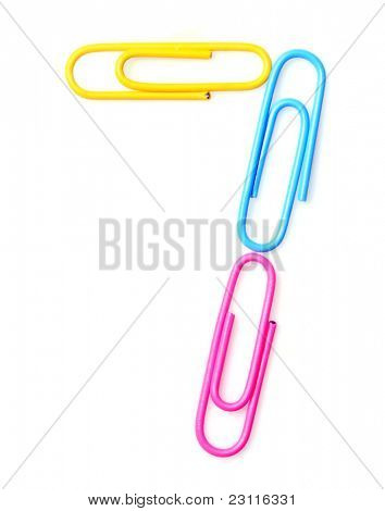 Colorful number seven from paperclips. One part of funny school or office alphabet.