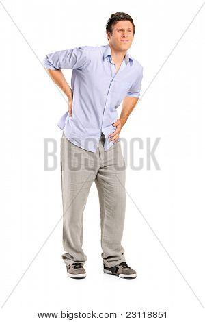 Full length portrait of a young man suffering from a back pain isolated on white background