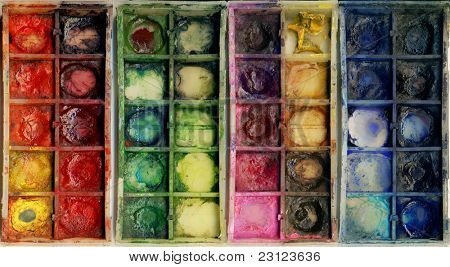 closeup of old used paintbox