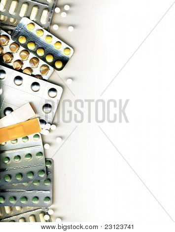 Background made of different pills, isolated on white