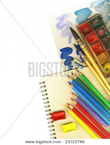 Clipping path. Creative Art Background made of old paint brushes, albums, palette, colored pencils and other tools for drawing