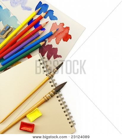 Creative Art Background made of old paint brushes, albums, palette, colored pencils and other tools for drawing