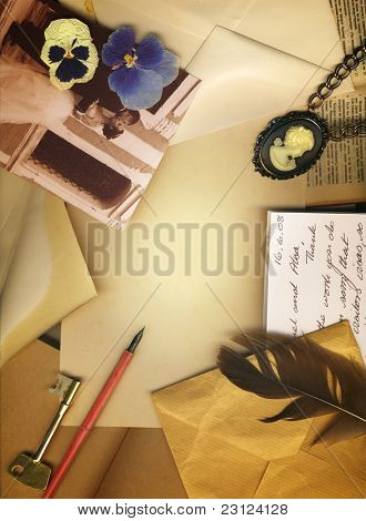 Vintage background with old letters, dry flowers, a key, postcards and photographs