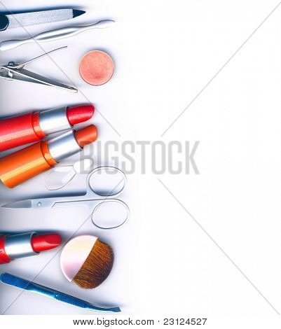 makeup brush and cosmetics, on a white background isolated