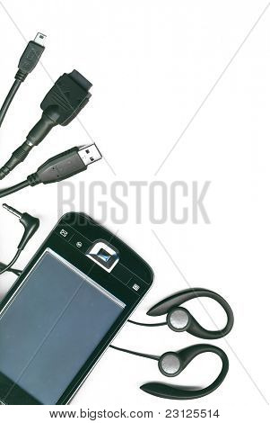 A collection of different electronic cables and pda on a white background, isolated