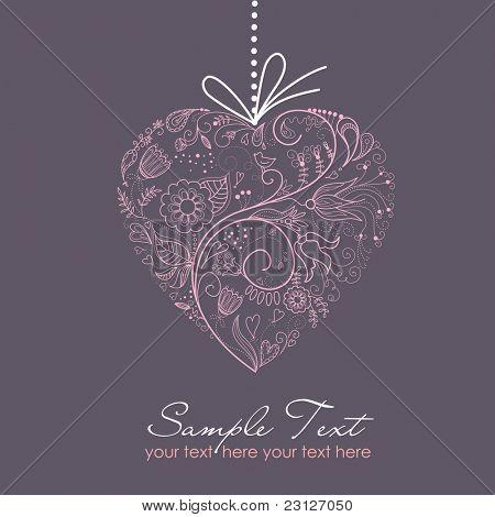 Corazón de color rosa sobre fondo gris