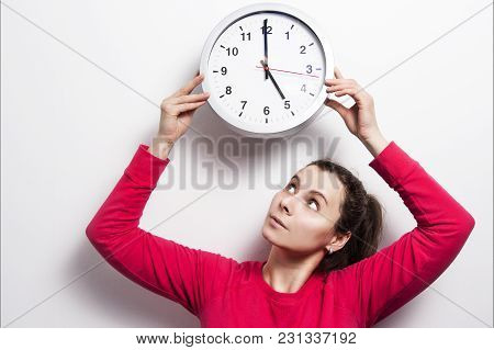 poster of Watch The Time Concept. The Girl Is Holding Round Classic Watch Over Her Head. Young Brunette Woman