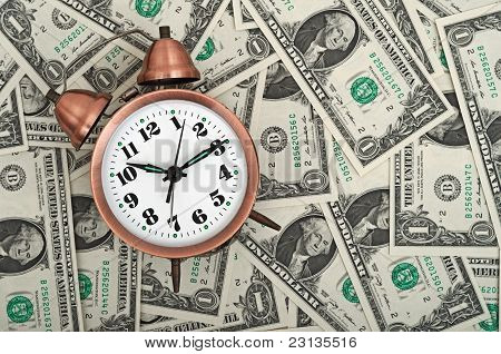 Alarm clock and dollars