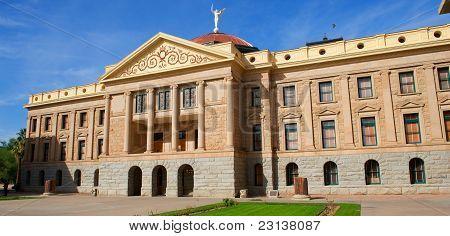 Arizona State Capital With Windows, Pillars, Bright Blue Sky And Green Grass