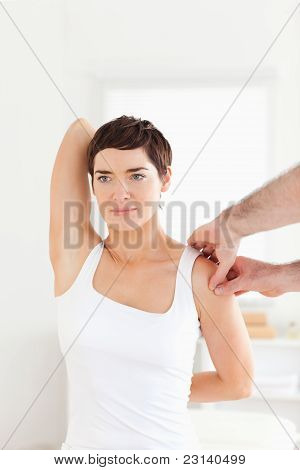Brunette Patient Doing Some Exercises Under Supervision