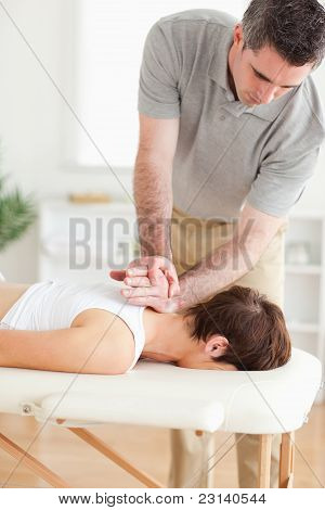 Masseur Massaging A Female Customer's Neck