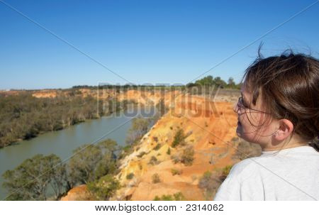 Girl Looking Over River