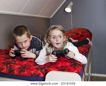 Siblings Playing Video Games