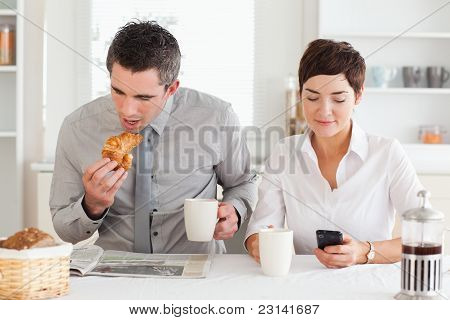 Couple Having Breakfast Before Work