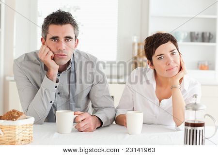Tired Couple Drinking Coffee