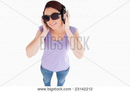 Smiling Woman With Headphones And Sunglasses