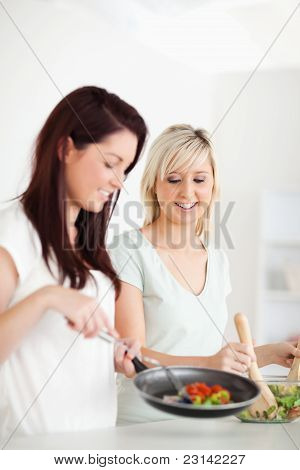 Joyful Women Cooking Dinner