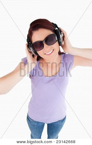 Young Woman With Headphones And Sunglasses