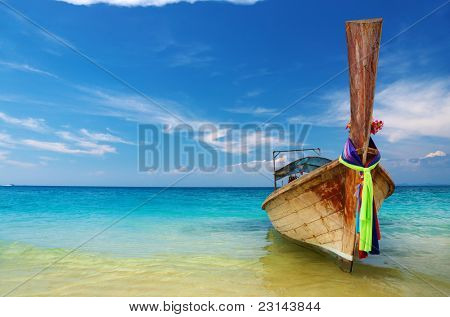 Tropical beach with thai longtail boat, Andaman Sea, Thailand