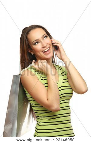 Closeup portrait of a cute young woman using mobile while holding shopping bag