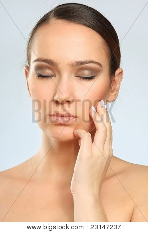 Portrait of beautiful woman, she has toothache isolated on grey
