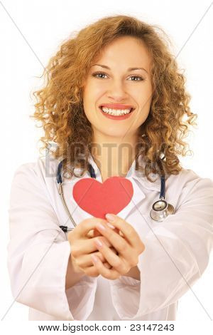 Young beautiful female cardiologist with a paper heart isolated on white background