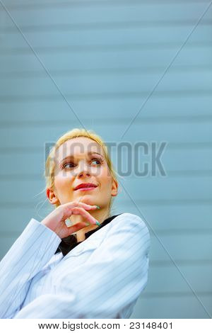 Portrait Of Thoughtful Business Woman Standing At Office Building
