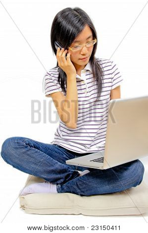 Young Chinese Woman Sitting On The Floor With Laptop