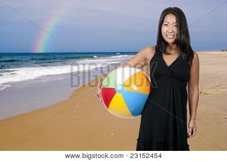 Asian Woman Holding Beachball