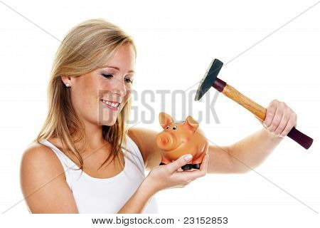 young woman slaughters her piggy bank
