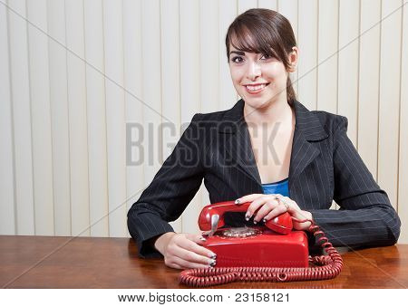 Professional woman with rotary phone