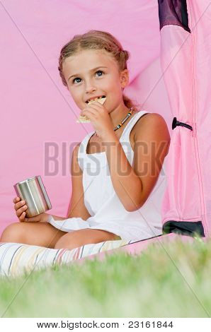 Happy childhood - Camping in tent - girl on camp tent