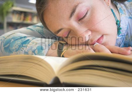 Beautiful Student Sleeping On The Library