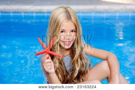 children  girl in summer vacation  pool with starfish