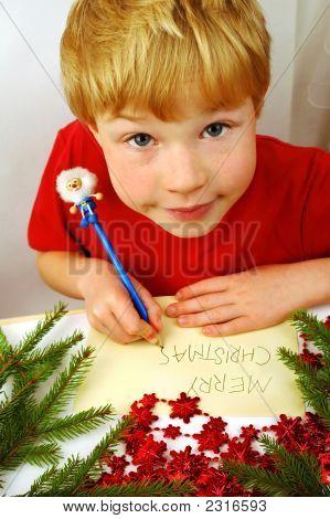 Boy Writing Christmas Wishes