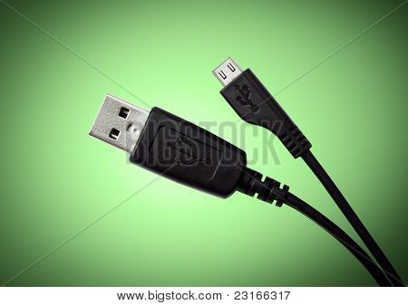 Black USB cable on green background