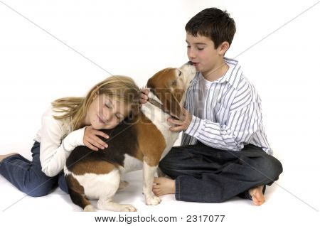 Boy And Girl With Beagle Dog